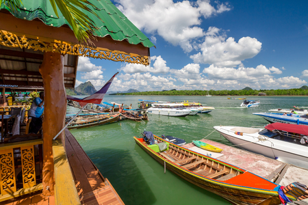 speedboats: Ao Phang Nga National Park, Krabi, Thailand - January 6, 2016: Historical floating Koh Panyi settlement, also known as Koh Panyee, muslim fishing village built on stilts of Phang Nga Bay