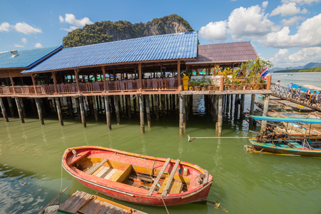 phang nga: Ao Phang Nga National Park, Krabi, Thailand - January 6, 2016: Historical floating Koh Panyi settlement, also known as Koh Panyee, muslim fishing village built on stilts of Phang Nga Bay