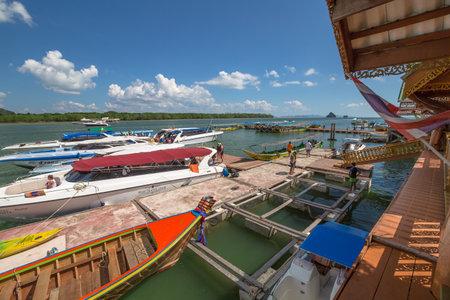 panyi: Ao Phang Nga National Park, Krabi, Thailand - January 6, 2016:Historical floating Koh Panyi settlement, also known as Koh Panyee, muslim fishing village built on stilts of Phang Nga Bay