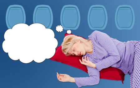 peacefully: Woman dreaming peacefully and safe in a plane on a comfortable flight, blue background, copy space.