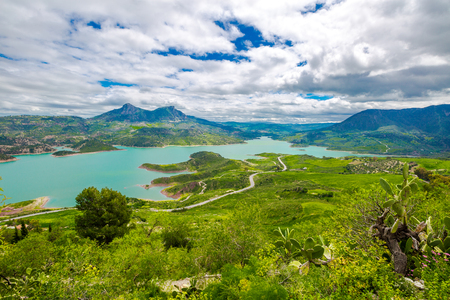 Spectacular aerial view of Lake Zahara from Castle of Zahara de la Sierra, a famous village de la Ruta de los Pueblos Blancos, white villages, between Cadiz and Malaga, Andalusia, Spain. Stock Photo - 58380761