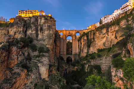 nuevo: The popular historic landmark of spectacular Puente Nuevo, New Bridge, at dusk over Guadalevin River in town of Ronda, Andalusia, Spain. Stock Photo