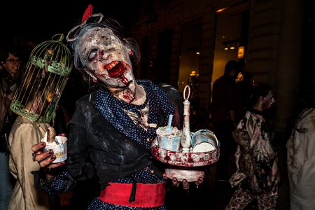 terrifying: Bologna, Italy - May 21, 2016: Bologna zombie apocalypse walk. Close up of the face of a rotten, bloody and terrifying zombie. Editorial