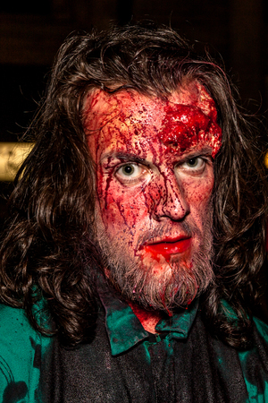 terrifying: Bologna, Italy - May 21, 2016: Bologna zombie apocalypse walk. Portrait of a bloody and terrifying zombie.