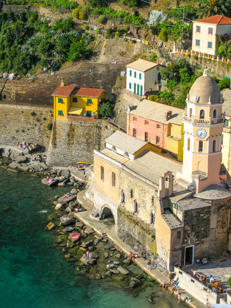 santas village: Vernazza in National Park of Cinque Terre. Aerial view of church Santa Margherita from the Tower of Doria Castle. Liguria, Italy. Stock Photo
