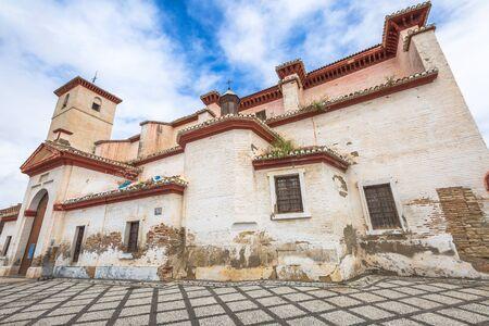 historic district: Iglesia de San Nicolas is located in the historic district of Albaicin of Granada in Andalusia, Spain and is popular for the Mirador de San Nicolas with a spectacular view of Alhambra de Granada.