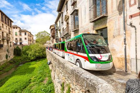 carrera: Granada, Andalucia, Spain - April 16, 2016: Granada City Tour with the shuttle along the Carrera del Darro in the popular old Moorish Albaicin quarter. Its located on a hill facing the Alhambra. Editorial