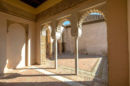 declared: Malaga, Andalucia, Spain - April 16, 2016: inside with portico and columns in Alcazaba. The place is declared Unesco World Heritage Site.