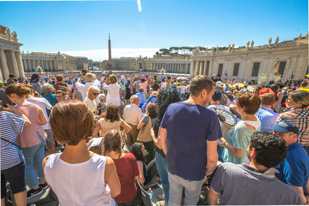 st  peter's square: Rome, Italy - June 18, 2016: close up of people while you listen to Pope Francesco speaking for jubilee event in St. Peters Square, Vatican.