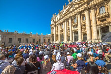st  peter's basilica pope: Rome, Italy - June 18, 2016: close up of people who listen to the Pope Francesco in St. Peters Square for jubilee event. On background, the San Pietro Basilica. Editorial