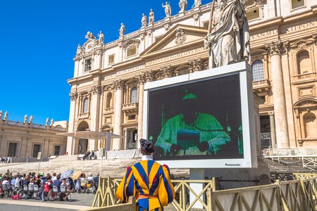 st  peter's basilica pope: Rome, Italy - June 18, 2016: Pope Francesco speaking in Piazza San Pietro for jubilee event. On background, the Basilica di San Pietro or St. Peters Basilica. Editorial