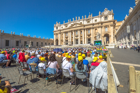 st  peter's basilica pope: Rome, Italy - June 18, 2016: Pope Francesco speaking in Piazza San Pietro for jubilee event. On background, the popular landmark of St. Peters Basilica.