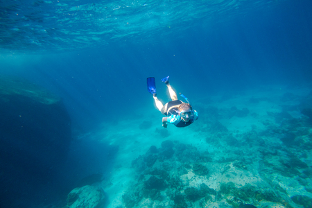 similan islands: Young female apnea swims in deep waters of the popular Similan Islands in Thailand, Andaman Sea. Stock Photo