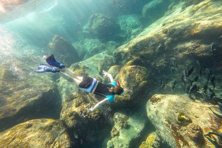 similan islands: Man apnea swims in deep waters of the popular Similan Islands in Thailand, Andaman Sea.