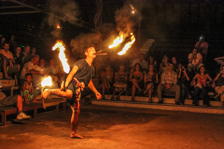 oper: Chiang Mai, Thailand - July 24, 2011: Fire eater performs in a shows at outside the Kantoke Palace in oper air place