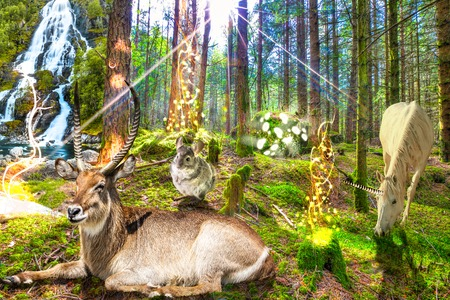 Magical enchanted forest with unicorn, magic animals and a waterfall Stock Photo