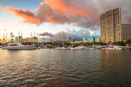 Skyline at sunset of Ala Wai Harbor the largest yacht harbor of Hawaii. Honolulu, Oahu in Hawaii, United States.