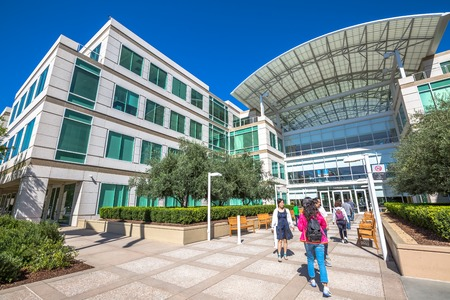 Cupertino, CA, USA - August 15, 2016: people walk in front of the Apple Inc Headquarters at One Infinite Loop located in Cupertino, California.