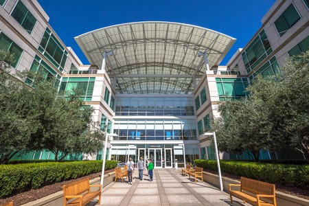 trademark: Cupertino, CA, USA - August 15, 2016: people walk in front of the Apple world headquarters at One Infinite Loop. Apple is a multinational corporation that produces technology devise.