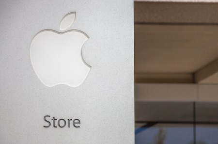 consumer electronics: Cupertino, CA, USA - August 15, 2016: Apple sign of Apple store at One Infinite Loop. Apple is a multinational corporation that produces consumer electronics, computers, software. Editorial