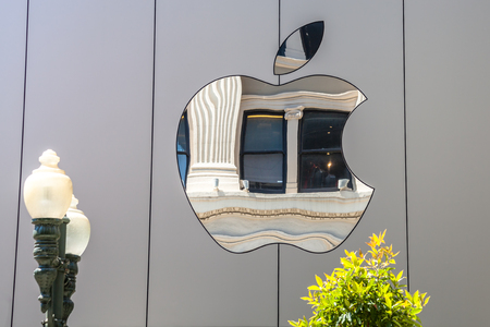 Cupertino, CA, USA - August 15, 2016: Apple sign on the Apple world headquarters at One Infinite Loop, Cupertino in Silicon Valley. Apple Inc. is an American multinational technology company.