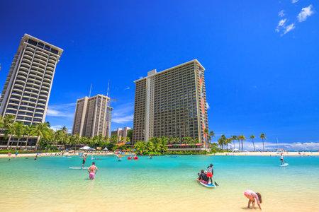 Waikiki, Oahu, HI - August 18, 2016: Hilton Hawaiian Village to the left of Duke Kahanamoku Beach. The beach is one of more popular of Waikiki Beaches because it offers a swimming area protected.