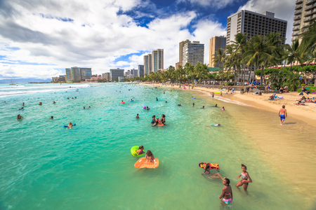 Waikiki, Oahu, HI - August 27, 2016: Prince Kuhio Beach also called The Ponds, because bounded by concrete walls that have created a calm water swimming pool. Kuhio Beach is great for boogie boarding.
