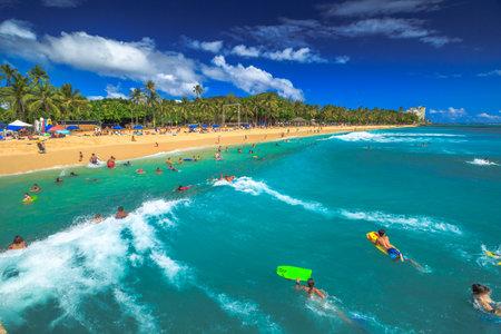 bodyboarding: Waikiki, Oahu, Hawaii - August 27, 2016: Boogie boarding, bodyboarding also called, is a popular water sport practiced in Waikiki Beach near the Waikiki Pier at Queens Surf Beach in Honolulu.