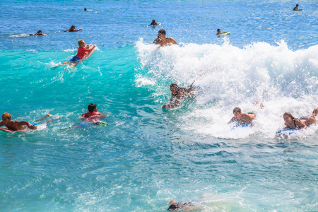 oahu: Waikiki, Oahu, Hawaii - August 27, 2016: children and teens have fun with the most popular watersport Waikiki Beach in Honolulu: the boogie boarding or bodyboarding. Editorial