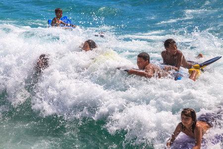 bodyboarding: Waikiki, Oahu, Hawaii - August 27, 2016: the funny and most popular water sports of Waikiki Beach in Honolulu: the boogie boarding or bodyboarding.
