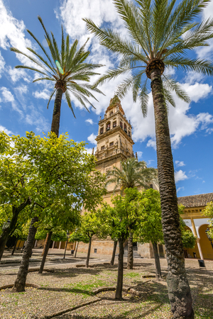 The bell tower Alminar and former minaret, also known as the courtyard of orange trees, of Mosque of Cordoba converted to a Cathedral in the 1500 in Andalusia, Spain. Editorial