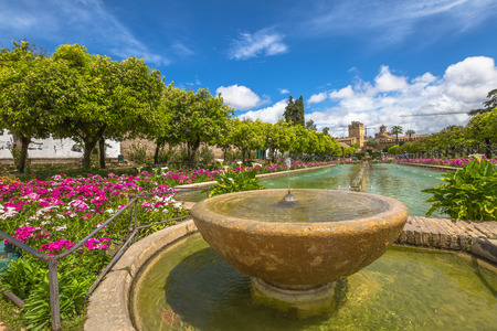 tourist attraction: Close up of fountain in the popular gardens of Alcazar de los Reyes Cristianos, Andalusian city of Cordoba, Spain.