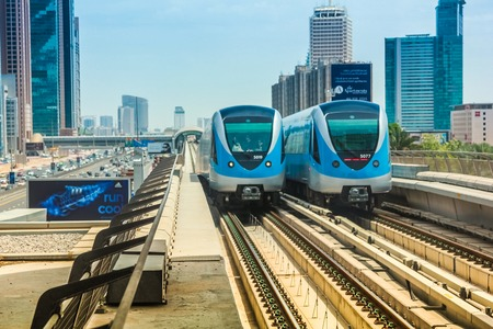 metro train: Dubai, United Arab Emirates - May 1, 2013: Dubai Metro the worlds longest fully automated metro network. Dubai Metro train along the Red Line.