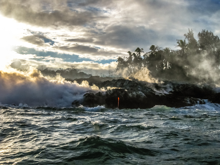 Kilauea Volcano in Hawaii Volcanoes National Park, also known Kilauea Smile because from 2016 seems to smile, erupting lava into Pacific Ocean, Big Island. Scenic sea view of lava rivers into the sea.