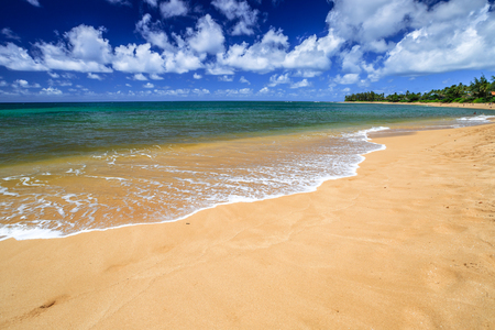 banzai pipeline: The popular Sunset Beach, North Shore, Oahu, Hawaii, in the summer when the sea is calm and flat.
