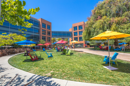 google chrome: Mountain View, California, United States - August 15, 2016: dining and relaxing area with colorated parasols and deck chairs for sunbathing for Google employees at Googles headquarters or Googleplex.