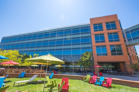 google chrome: Mountain View, CA, USA - August 15, 2016: dining and relaxing area with colorful parasols and deck chairs for sunbathing for Google employees at Googles headquarters or Googleplex. Editorial