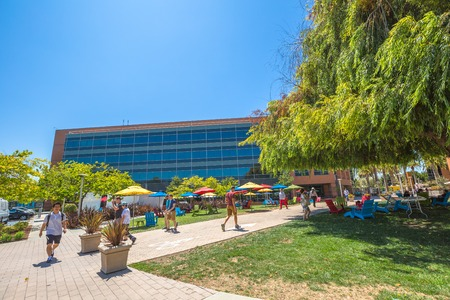 google chrome: Mountain View, CA, USA - August 15, 2016: Google employees walking in relaxing area at Googles headquarters or Googleplex. Google is a multinational company specializing in Internet-related services.
