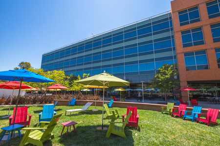google chrome: Mountain View, CA, USA - August 15, 2016: dining and relaxing area with parasols and deck chairs for sunbathing for Google employees at Googles headquarters or Googleplex.