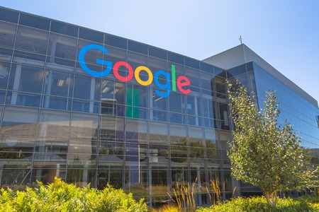 Mountain View, California, USA - August 15, 2016: Google sign on one of the Google buildings. Google is an American multinational corporation specializing in Internet services and products. Editorial