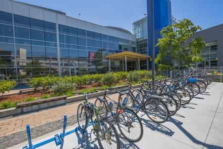 google chrome: Mountain View, California, United States - August 15, 2016: the bikes used by Google employees to move around the Google headquarters area, also called Googleplex. Google bicycle in its campus. Editorial