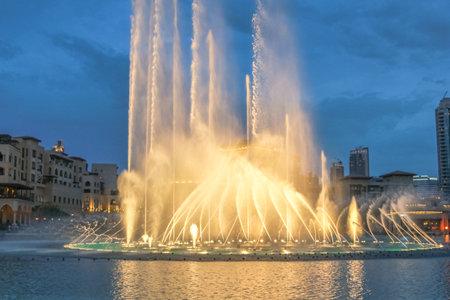 Night view of the light show at Dubai Fountain. The Dancing Fountain of Dubai performs to the beat of music near Burj Khalifa and Dubai Mall in downtown of Dubai. Editorial