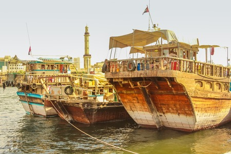 bur dubai: Dubai, United Arab Emirates - May 3, 2013: close up of traditional wooden fishing boats docked on Bay Creek.The creek divides the city into two main sections Deira and Bur Dubai old downtown of Dubai.