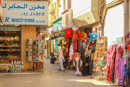 bur dubai: Dubai, United Arab Emirates - May 3, 2013: the traditional Grand Souk in Old Deira, historical Dubai. Arabs and tourists make shopping in traditional Souk.