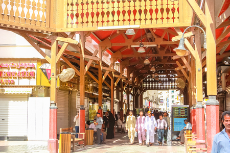 gold souk: Dubai, United Arab Emirates - May 3, 2013: the entrance to the famous Gold Souk in Deira Dubai in the old Dubai Creek. Arabs and workers walking in traditional Souk.