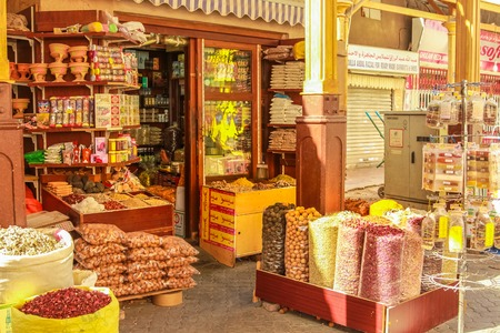 spice: Dubai, UAE - May 3, 2013: a typical colors spice shop in Old Deira. The Grand Souk Deira is an entire neighborhood of narrow streets and dark and bottege selling spices, gold, perfumes.