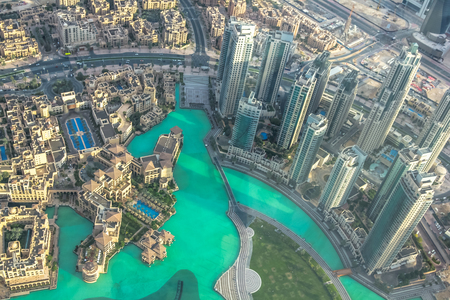 Aerial view of Dubai Fountain area, Burj Khalifa Lake and skyscrapers of Old Town Island in Dubai downtown, United Arab Emirates, from top. Stock Photo - 63400487