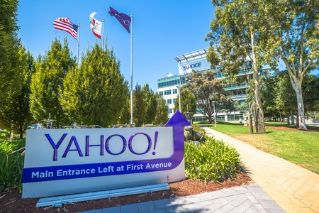 Sunnyvale, California, United States - August 15, 2016: flags in front of Yahoo Headquarters with American Flag and flag with Yahoo icon. Yahoo is a multinational technology company.