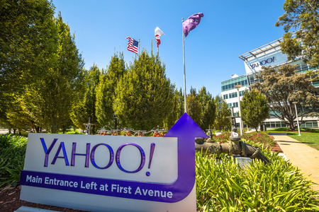 Sunnyvale, California, United States - August 15, 2016: flags in front of Yahoo Headquarters Main Entrance in Sunnyvale with American Flag and flag with Yahoo icon.