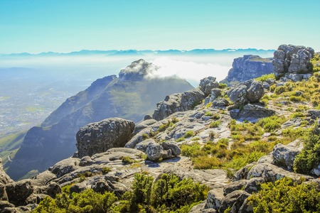 Low clouds over the Table Mountain National Park, a Unesco Heritage in Cape Town, Western Cape, South Africa.
